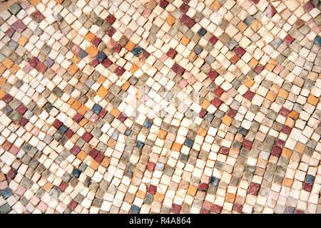 Detail of ancient byzantine natural stone tile mosaics, Jordan, Middle East - Stock Photo