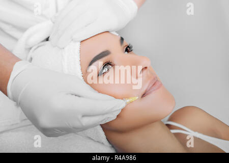 woman having facial injections for facelift and anti-aging effect - Stock Photo