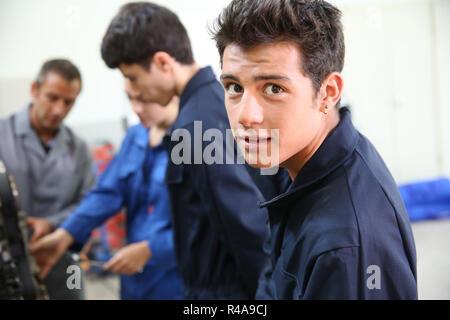Portrait of student in auto mechanics - Stock Photo
