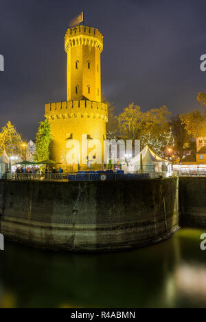 View of the illuminated Malakoff Tower at Night on the Rhine in Germany Cologne 2018. - Stock Photo