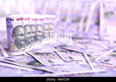 Indian money- Hundred Rupee Notes. Isolated on the white background. - Stock Photo