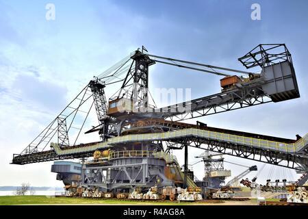 rusty coal excavator in the decommissioned lignite opencast mine Ferropolis - Stock Photo