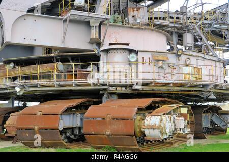 discarded lignite excavator in the disused opencast mine Ferropolis - Stock Photo