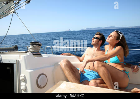 Lucky couple relaxing on sailboat deck - Stock Photo