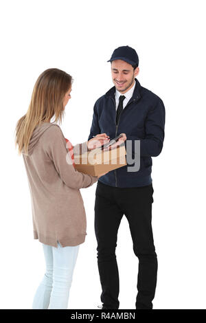 Woman signing receipt of package delivery - Stock Photo