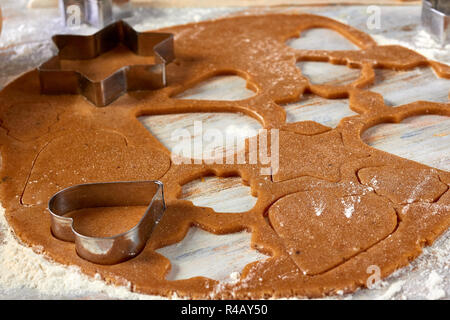 Raw gingerbread dough rolled out on table - Stock Photo