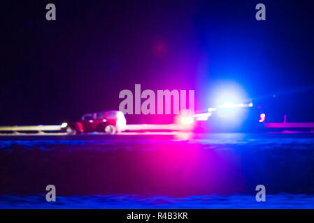 Police officer car catching a car with over speed limit at night time.  blurred. - Stock Photo