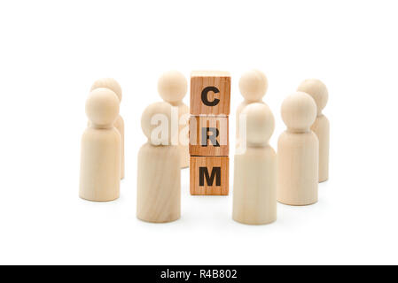 Wooden figures as business team in circle around acronym CRM Customer Relationship Management, isolated on white background, minimalist concept - Stock Photo