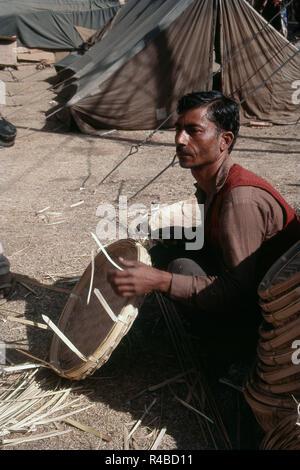Man making topli of cane bamboo, Kulu, Himachal Pradesh, India, Asia - Stock Photo