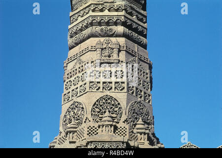Richly carved minaret of Rani Sipri's Mosque, Ahmedabad, Gujarat, India, Asia - Stock Photo