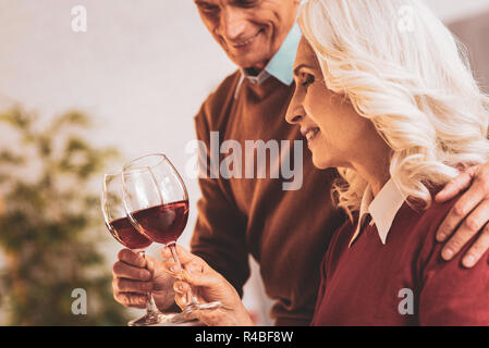 Wine evening. Couple of happy aged people feeling unforgettable while enjoying nice wine evening together - Stock Photo