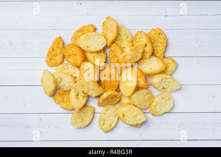 Croutons of white bread baguette with spices in dishes - Stock Photo