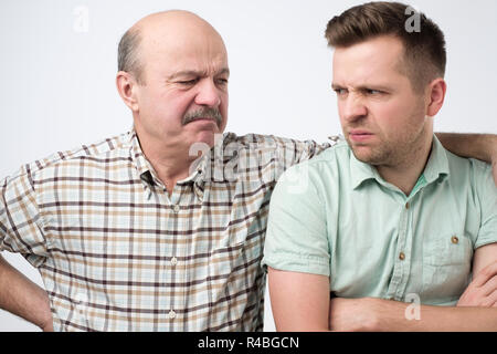 Angry father and son having an argument - Stock Photo