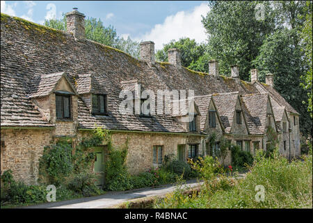Pretty cottages of Arlington Row situated in the historical Bibury village, Gloucestershire England UK - Stock Photo