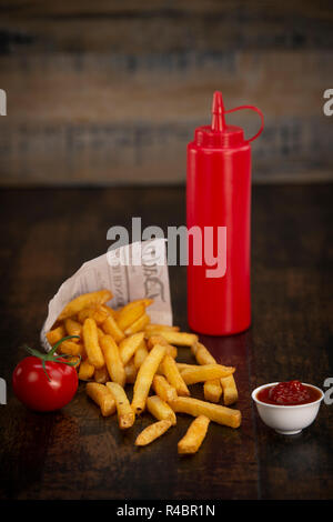 French fries in a paper bag - Stock Photo