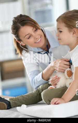 Doctor examining little girl with stethoscope - Stock Photo
