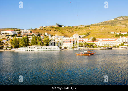 Pinhao, Portugal - October 05, 2018 : Boat carrying tourists on the Douro River, Vila Real, Portugal - Stock Photo