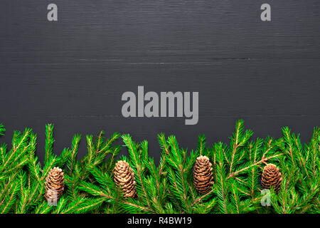 Christmas Border made of natural fir tree branches on black, Flat lay mock-up for restaurant menu - Stock Photo