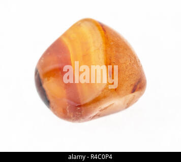 macro shooting of natural mineral rock specimen - carnelian (cornelian) gemstone on white background - Stock Photo
