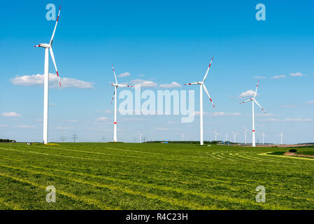 windmills in a mown field in germany - Stock Photo