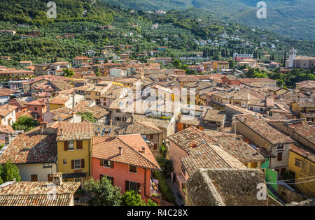 View over Lake Garda over the tiled roofs of Malcesine, Lake Garda, Italy. Veneto region of Italy. Aerial view, top view - Stock Photo
