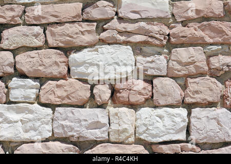 Wall made from white and pink limestone - Stock Photo