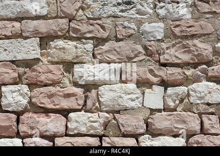 Wall made from stones of the Mount Subasio in Italy - Stock Photo