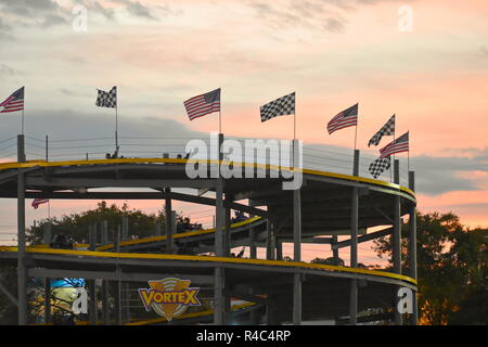 Orlando, Florida.  November 19, 2018 . Track with double-seat go-karts on colorful sunset background at Kissimme area. - Stock Photo