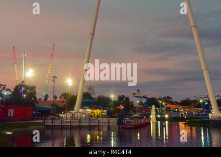 Orlando, Florida.  November 19, 2018 Colorful attractions in Fun Spot Park on beautiful sunset background at Kissimmee area. - Stock Photo