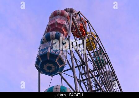 Orlando, Florida.  November 19, 2018 Colorful Ferris wheel on lightblue sky background at Old Town Kissimmee. - Stock Photo