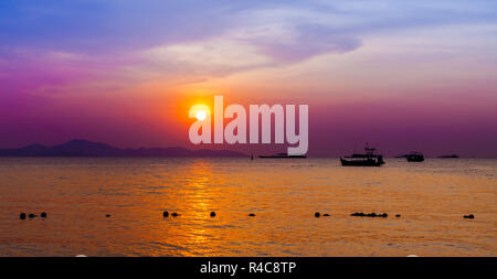 Beautiful landscape. sunset on the beach with fishing boat - Stock Photo