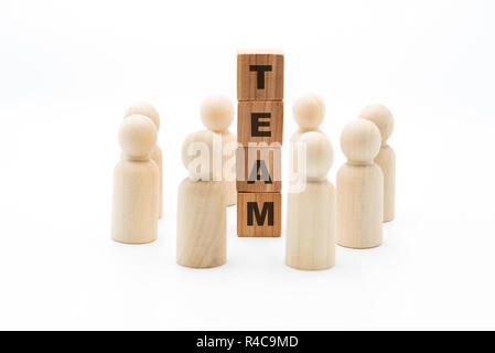 Wooden figures as business team in circle around word TEAM, isolated on white background, minimalist concept - Stock Photo