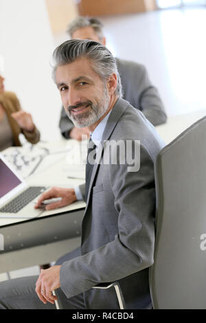 Portrait of architect meeting with clients in office - Stock Photo