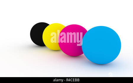 Coloured spheres representing the CMYK color model - Stock Photo