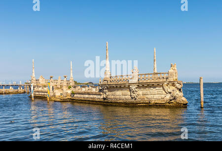 stone breakwater barge at the vizcaya museum and gardens on biscayne bay - Stock Photo
