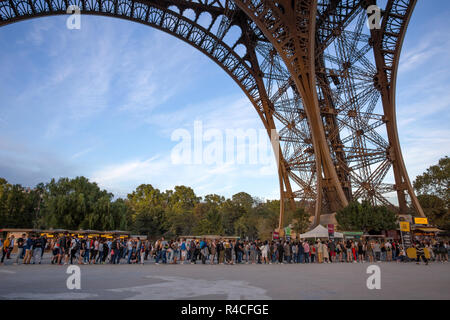 PARIS, FRANCE, SEPTEMBER 8, 2018 - People waiting in long queue at Eiffel Tower in Paris, France - Stock Photo