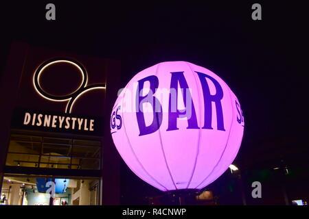 Orlando, Florida. November 18 , 2018 Illuminated magenta bar balloon at night in  Lake Buena Vista . - Stock Photo