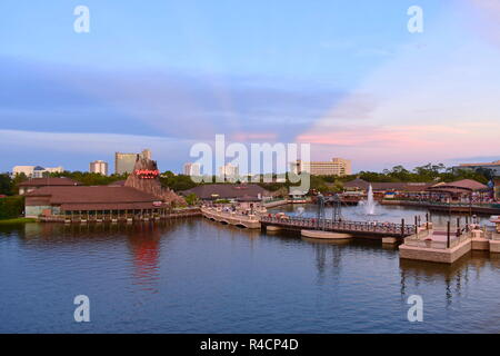 Orlando, Florida. November 18, 2018 Panoramic view of Volcano, vintage bridge , hotels and outside market on sunset with magenta rays at Disney Spring - Stock Photo