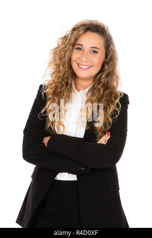 Smiling girl with curly blonde hair, she is standing with her arms crossed, wearing a black suit and white shirt - Stock Photo