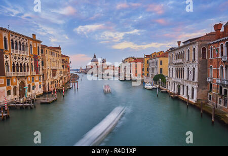 Venice. Cityscape image of Grand Canal in Venice, with Santa Maria della Salute Basilica in the background. - Stock Photo