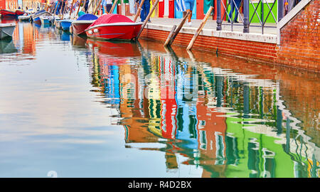 Reflection of a colorful houses in water canal, Burano island, Venice, Veneto region, Italy - Stock Photo