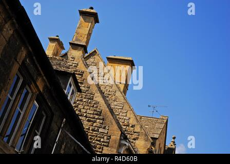 Roof line of Cotswold stone buildings in the market town of Chipping Campden, Cotswolds, Gloucestershire, UK - Stock Photo