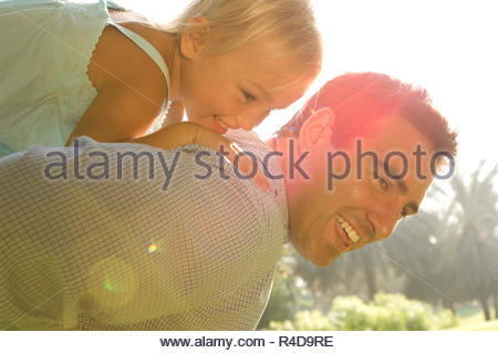 A young girl with her father - Stock Photo