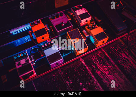 Guitar Pedals Stomp Boxes Red Yellow Blue. - Stock Photo