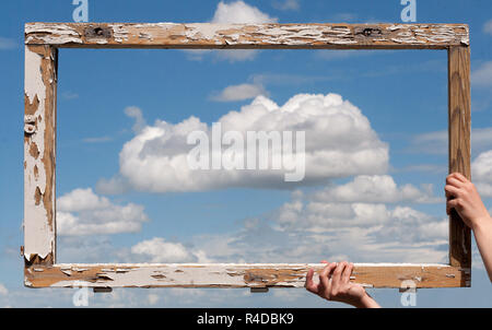 an old wooden frame kept against the sky - Stock Photo