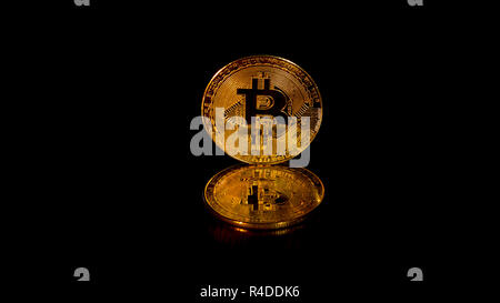 Gold crypto curency coins bitcoin on a black background. In addition to the lying coins, there are standing coins. - Stock Photo