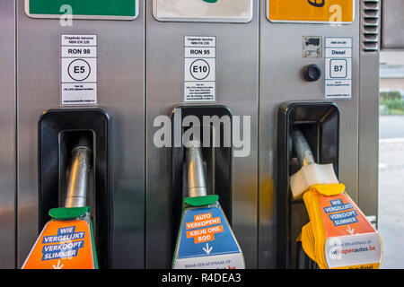 Color-coded gas pump nozzles and new EU fuel identification labels for gasoline E5 / E10 and diesel B7 at petrol station in Belgium, Europe - Stock Photo