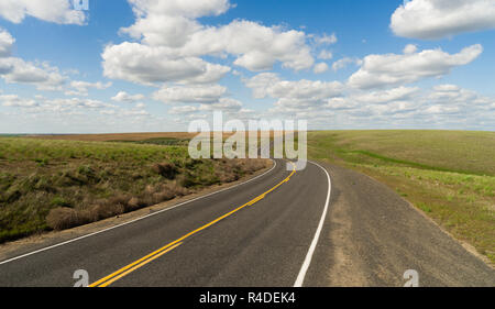 Long Winding Road Cury into The Distance Vanishing Point - Stock Photo
