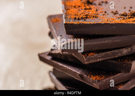 Stack of Chocolate Bars on light background - Stock Photo