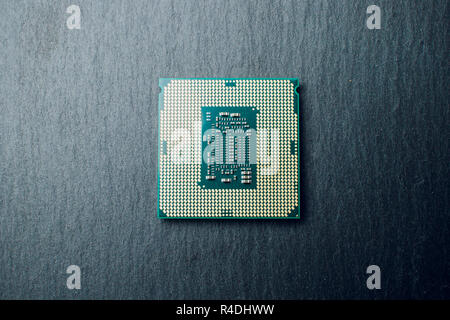 processor for computer isolated on a colored background - Stock Photo